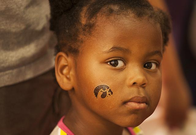 Young girl with a Hawkeye tattoo