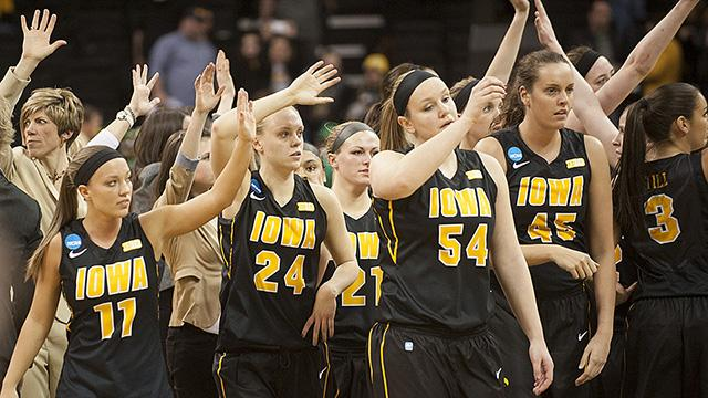 Iowa women's basketball team waves to the crowd after the game