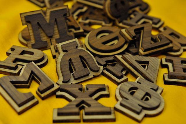 wooden greek symbols
