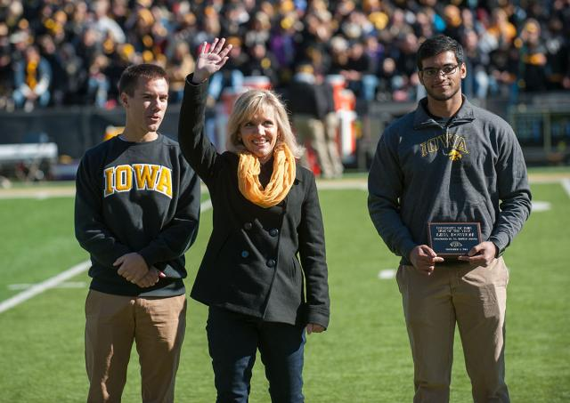 Mom of the Year accepts award on Kinnck field