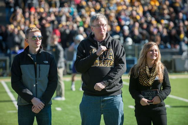 Dad of the Year accepts award on Kinnick field