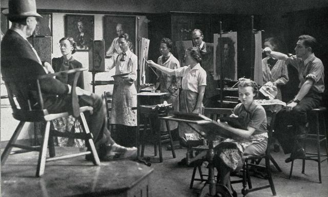 Black-and-white photo of students painting on easels in a class at the Art Building