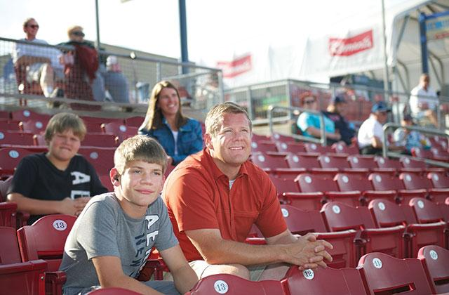 Jack Bickel with parents at a baseball game