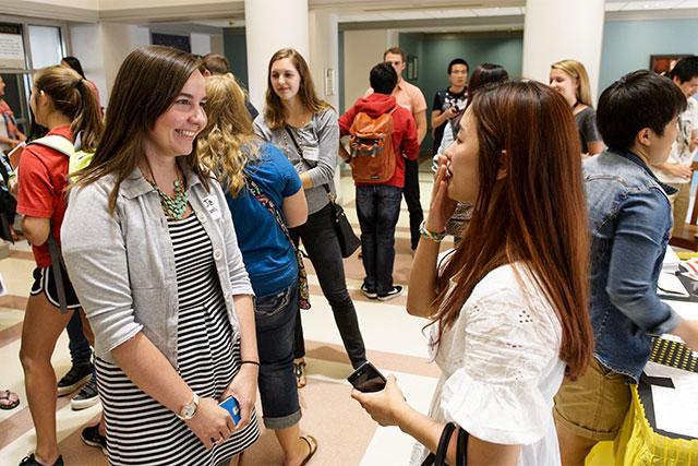 UI seniors Jade Manternach and Hyejung Kim meet for the first time during the International Buddies kickoff event on Friday, Sept. 19