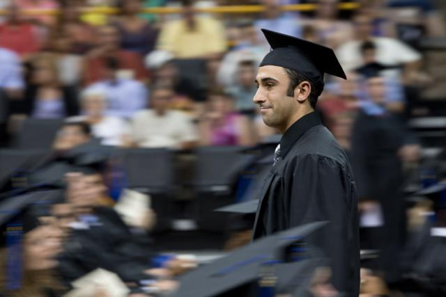A graduate at Tippie College of Business commencement