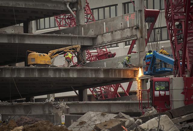 Workers dismantle a parking ramp