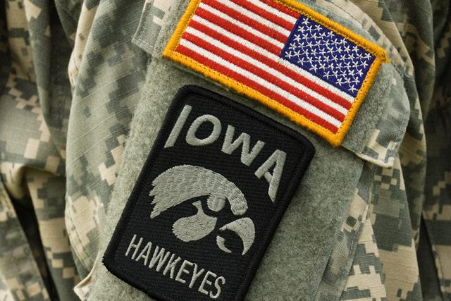 a u.s. flag patch and a tigerhawk patch on the arm of an ROTC member