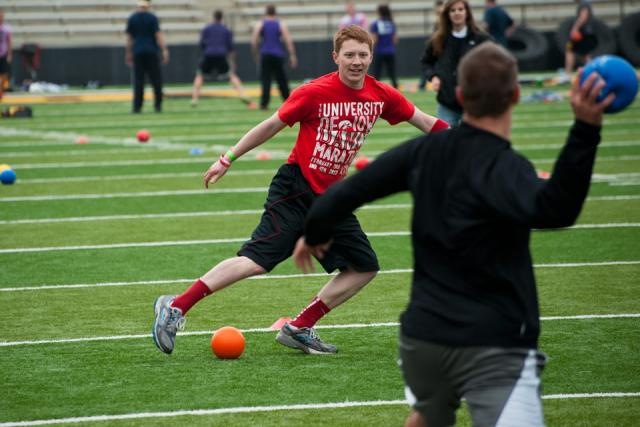 Students play dodgeball at Kinnick Stadium