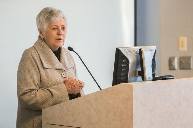President Sally Mason speaks at a podium.