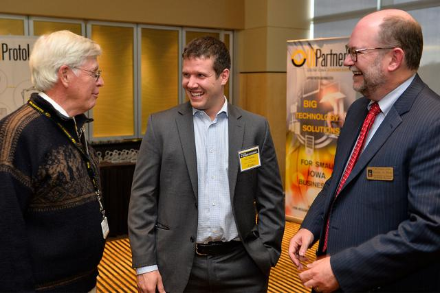 UI College of Dentistry and Dental Clinics Dean David Johnsen talks with several colleags at the Economic Devleopment Showcase Monday at Kinnick.