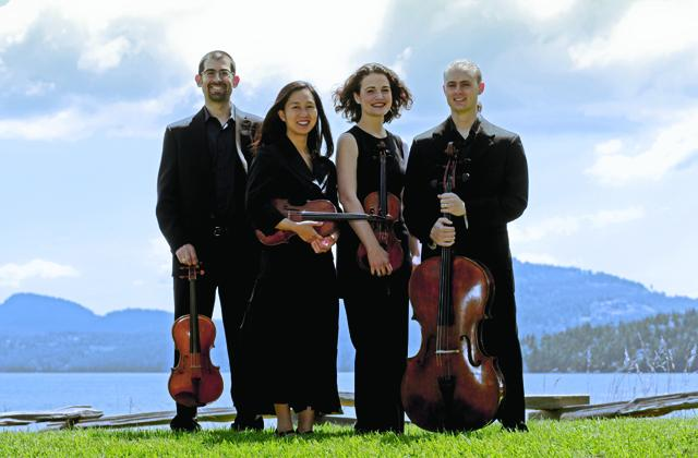 chiara quartet standing outside