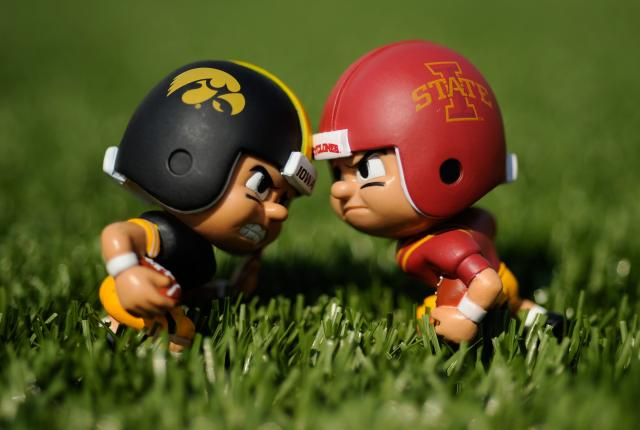 figurines wearing iowa and iowa state uniforms face off