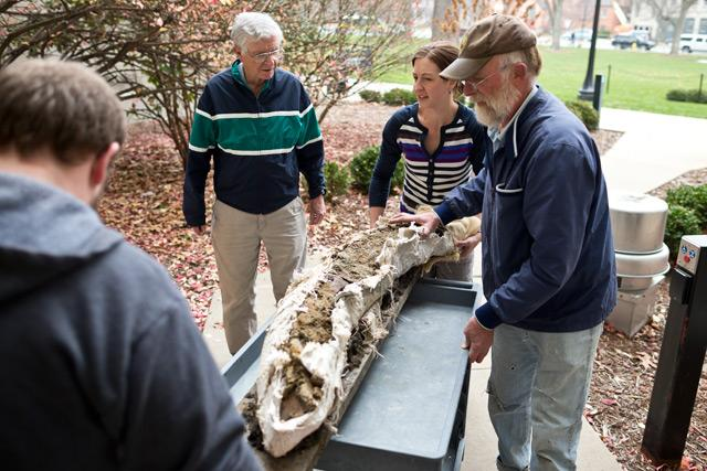 mammoth tusk being wheeled into the museum