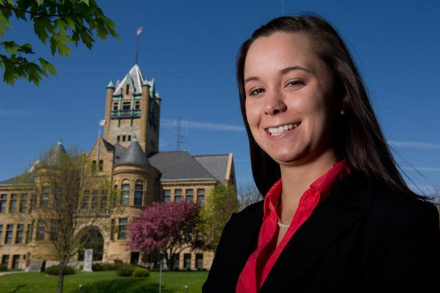Emily Ehlers in front of the Johnson County Courthouse