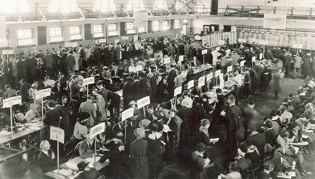 Black-and-white photo of students waiting in lines during registration at Library Annex in Old Armory, 1930s