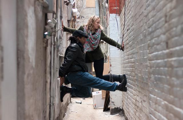 dancers posing in alley