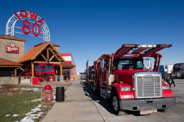 A truck rolls past the entrance to the Iowa 80 Truck Stop.