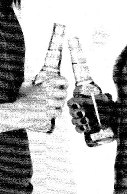 two people holding beer bottles
