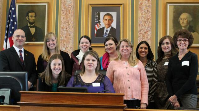 Rep. Dave Jacoby is pictured with University of Iowa College of Education School Counseling students at the State Capitol House Chambers. Pictured left to right: Rep. Jacoby, Lauren Hill, Haylie Miller, Christi Kreigh, Heidi Hunt, Rebecca Karas, Sue Farran, Sara Koslowski, and Dr. Carol Smith. Seated is Jaclyn Inaclang.