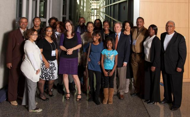 Extended members of Henrietta Lacks' family pose with author Rebecca Skloot