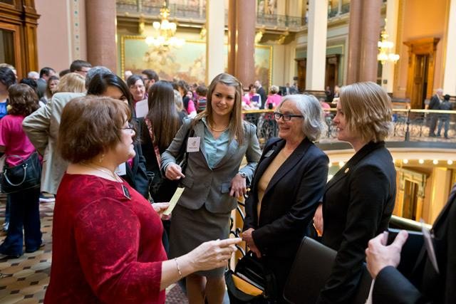 Representative Marti Anderson, left chats with first year law student Heather Jackson, from left, Law School Associate Dean Linda McGuire, and first year law student Kelli Lang in the Capiol Building.