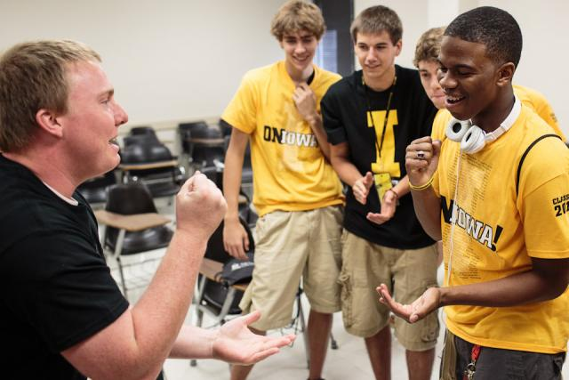 Students play rock, paper, scissors.