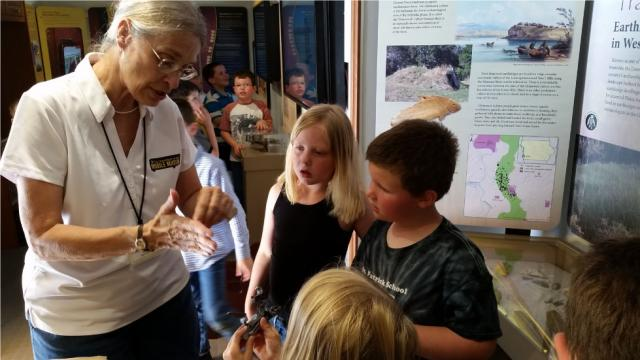 Mobile musuem staff member talking with young children