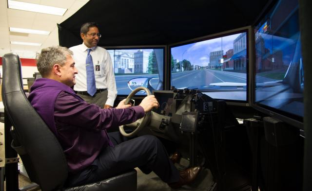 Igor Magomedovich Isaev experiences the National Advanced Driving Simulator.
