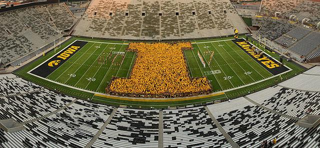 Students form block I on Kinnick Stadium field.