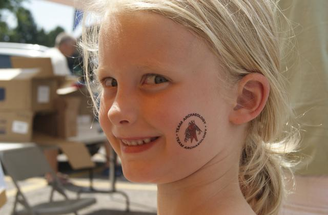 Georgie Oedekoven of Rock Rapids, Iowa, stopped by the Office of the State Archaeologist booth for a tattoo