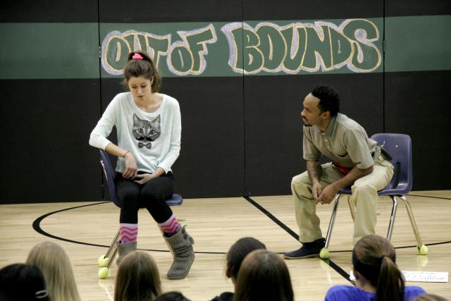 Barrington Vaxter, Emily Hinkler, and Elizabeth Hinkler (left to right) perform a scene from Working Group Theatre's Out of Bounds at Northwest Junior High School.
