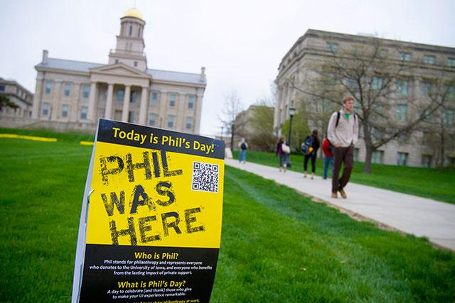 "Sign-reading ""Phil Was Here"" on the lawn in front of the Old Capitol"