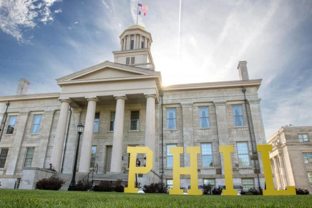 Large wooden letters spelled out P-H-I-L on the Pentacrest during Phil's Week to call attention to the impact of philanthropy on the UI campus.