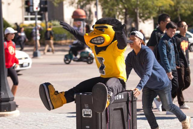 """Herky """"helps"""" the Pandelirium Steel Drum Band set up their instruments on the Pentacrest for the College of Liberal Arts & Sciences' We Are Phil celebration on Wednesday, September 30."""
