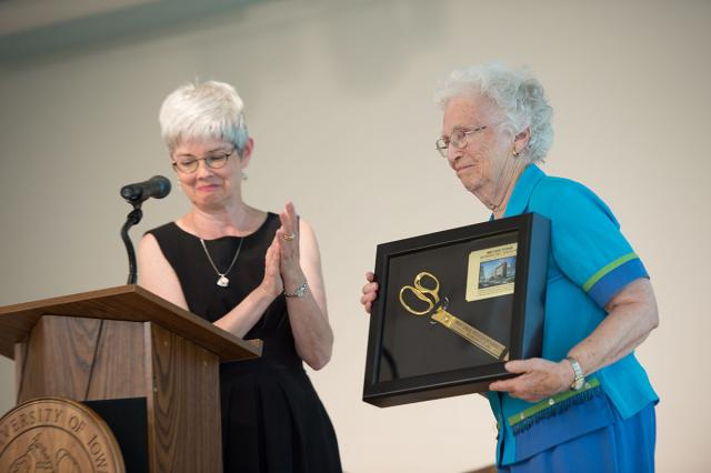 UI Foundation President Lynette Marshall presents Mary Louise Petersen with a framed memento during yesterday's dedication.
