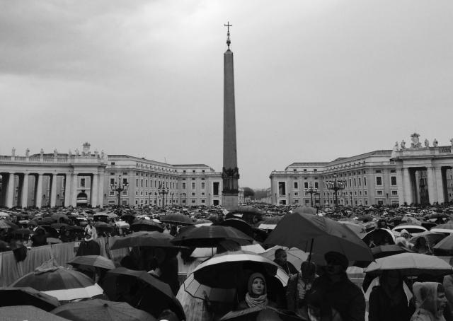 Crowd with umbrellas at Vatican City on a rainy Easter Sunday