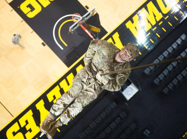Maj. Chris Guderski rappels about 66 feet from the rafters to the court in Carver-Hawkeye Arena.