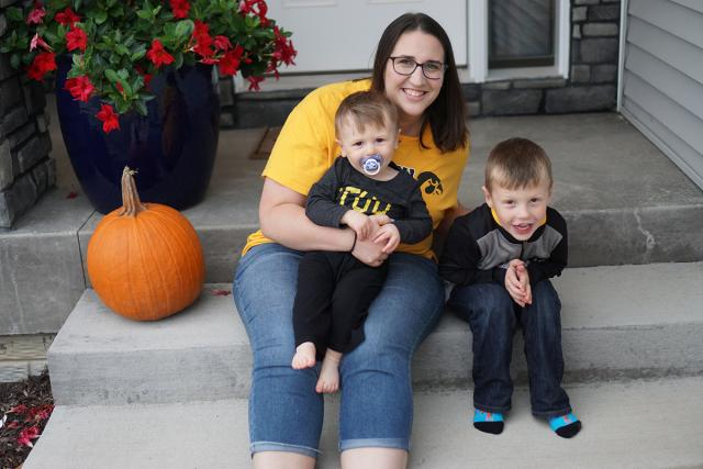 woman sitting on front steps with nephews