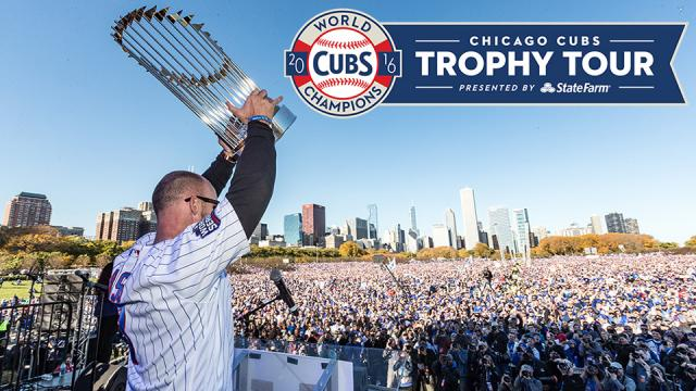 david ross holding world series trophy at chicago celebration
