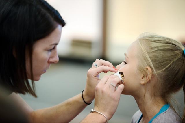 volunteer applying temporary tattoo