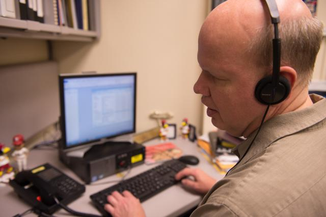 Mike Hoenig, program coordinator in the Center for Disabilities and Development, relies on accessibility features to work efficiently in his job. Hoenig has been blind since birth, and uses a screen-reading program on the computer.