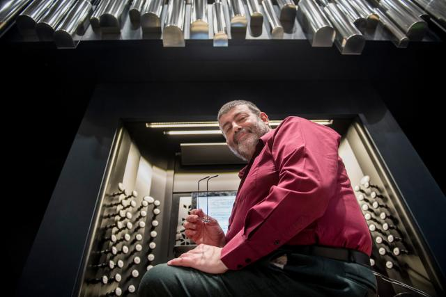 man in front of organ