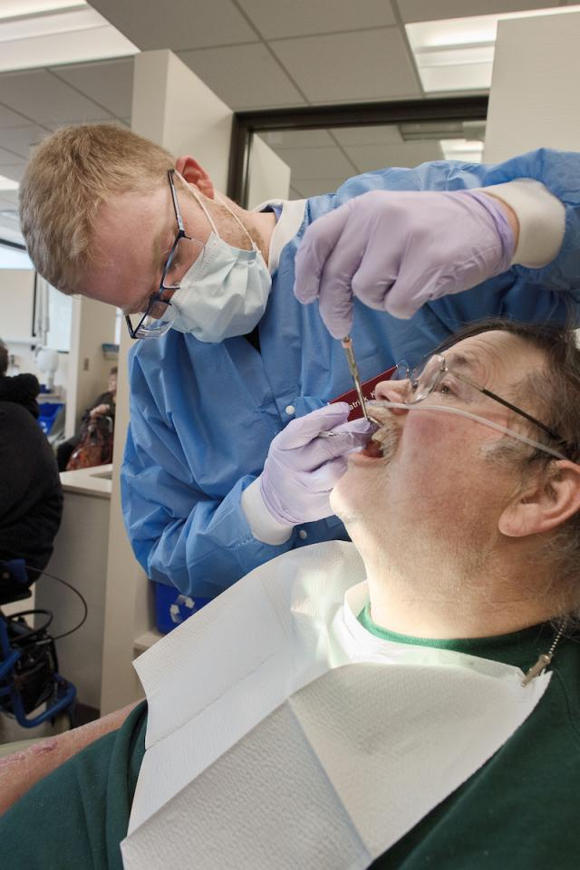 dental student attending to patient