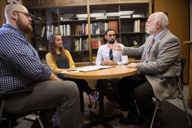 professor meeting with students