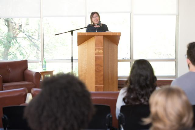 woman speaks during a master class on writing