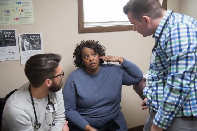University of Iowa nursing students meet with a patient at the Iowa City Free Medical Clinic