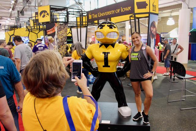 state fair attendee with herky statue
