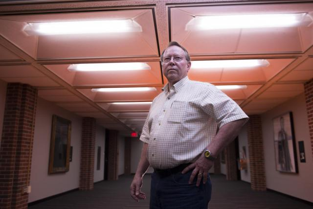 portrait of longtime university of iowa electrician marc brown in ui main library