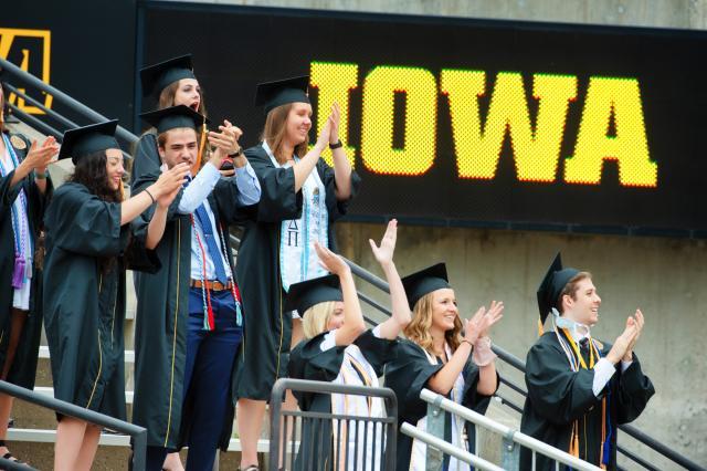 graduates at kinnick stadium