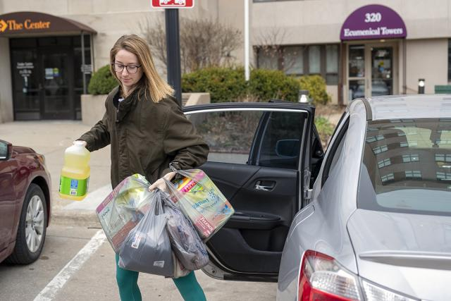 University of Iowa student Allie Stutting makes a grocery run that was requested of her group, the Iowa City Erranders